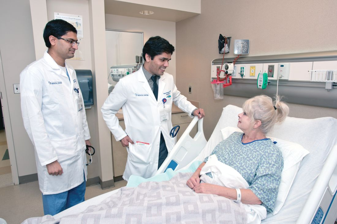 Dr. Raman Palabindala, center, and Dr. Chirag Acharya, an internal medicine resident, speak with a patient.