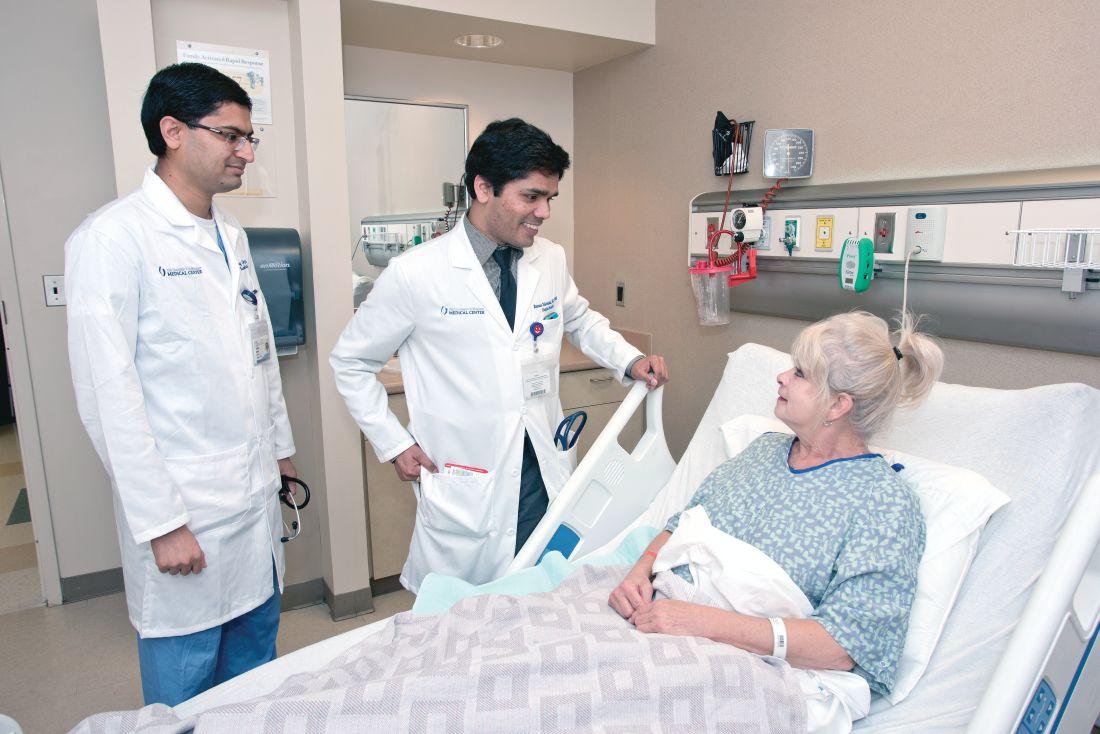 Dr. Raman Palabindala, center, and Dr. Chirag Acharya, an internal medicine resident, speak with a patient.