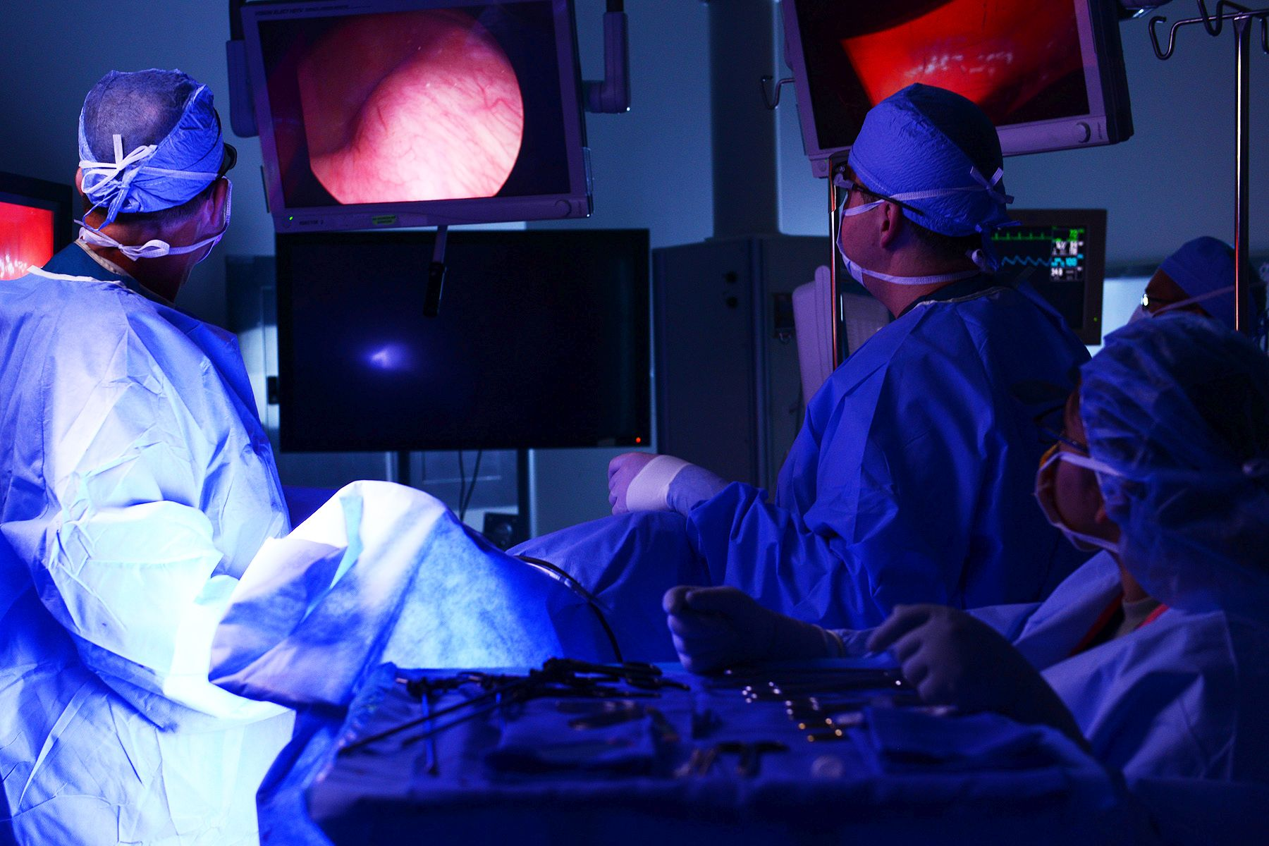 U.S. Air Force Maj. Arthur Greenwood and Capt. Stuart Winkler, 633rd Surgical Operations Squadron obstetricians, stitch up an incision after performing a laparoscopic hysterectomy at Langley Air Force Bae, Va., June 14, 2016.
