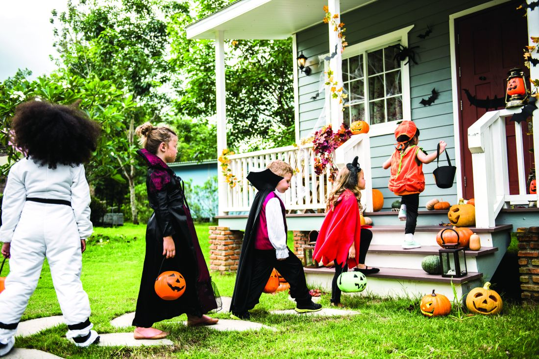 Children approach a door for trick or treating