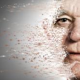 Man's face dissolving in air