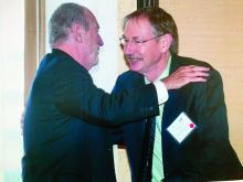 Dr. John A. Parrish, left, congratulates Dr. R. Rox Anderson on being recognized for his contributions to dermatology during a meeting of the American Society for Laser Medicine and Surgery.