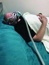 A man uses a CPAP device