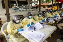 Health workers in the DRC earlier this year filled out forms before vaccinating people who'd been in contact with someone diagnosed with Ebola.