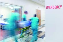 Doctors wheeling patient in the emergency department.