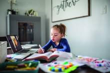 A girl participates in an online school session from home.