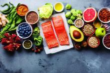 Healthy food selection: fish, fruit, vegetable, seeds, superfood, cereals, leaf vegetable
