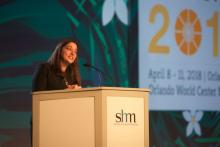 Dr. Nasim Asfar, the new president of SHM, speaking at Monday's HM18 opening plenary.