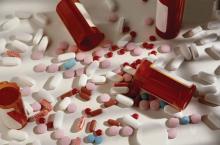 Empty pill bottles and pills