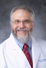 Dr. John W. Schmitt, professor of obstetrics and gynecology at Duke University