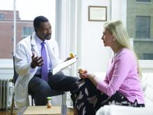 A doctor talks to a patient