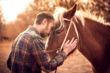 A man stands with his horse