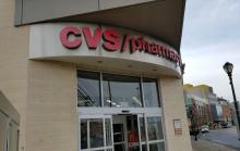 a photo of the front of a CVS pharmacy, showing its logo/name.