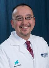 Dr. Henry Ng, an internal medicine physician and pediatrician in Cleveland