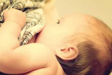 A baby breastfeeds