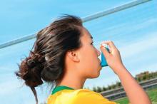 A girl using an asthma inhaler.