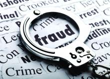 A handcuf laying over a paper, highlighting the word fraud.