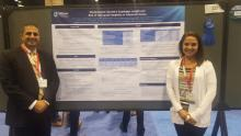Dr. Joseph Spataro and Dr. Christina Tofani stand in front of their poster a the meeting.