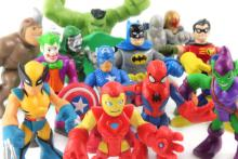 Small, colorful superhero statues are gathered for a superhero convention