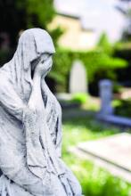 Statue of a grieving woman