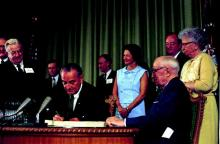 President Lyndon B. Johnson signed the Medicare bill on July 30, 1965.