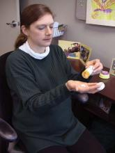 Pregnant woman in third trimester taking pills