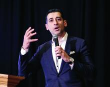 Dr. Chadi Nabhan, chief medical officer at Aptitude Health speaks to a group of community oncologists in February 2019.