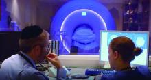 Dr. Lipton and a colleague observe a patient in an MRI.
