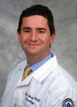 Dr. Bruce E. Strober