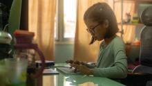 Elementary school student typing on keyboard