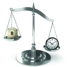 Money and clock on balance scale