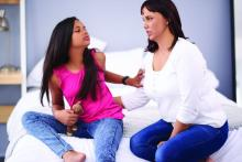 A mother tries talk to her teenage daughter