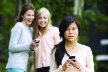 girl getting bullied on cell phone