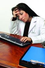 frustrated physician at computer