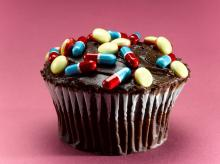 A picture of a cupcake covered with pills and tablets