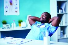 A doctor relaxes in his chair.