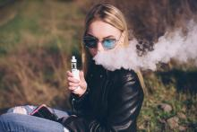 teen girl vaping ecigarette