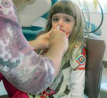A child receives H1N1 flu mist.