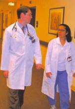 Dr. O'Leary, left, chats with a colleague at the Feinberg School of Medicine in Chicago.