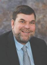 Dr. Brett M. Coldiron