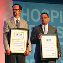 Drs. McIlraith (left) and Naseib on stage at HM13.