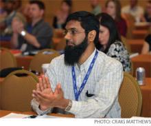 Mateen Dawood, MD, applauds an HM10 speaker.