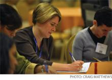 Rebecca Blankenburg, MD, MPH, takes a quiz during a limited-seating practice management workshop at HM10.