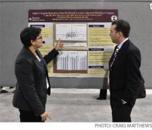 Tara Lagu, MD, MPH, (left) explains her RIV poster to Evan Fieldston, MD.