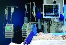 A patient in an intensive care unit room