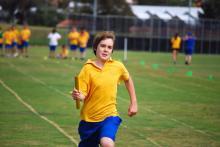 boy running a relay race
