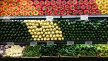 Produce displayed on grocery store shelves